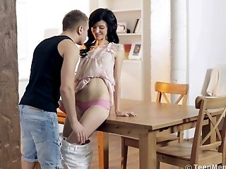 Black-haired cutie allows the boyfriend to bang her on the table