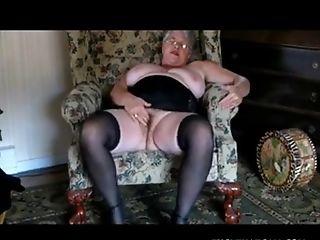 Beautiful granny strips off her underwear then masturbates