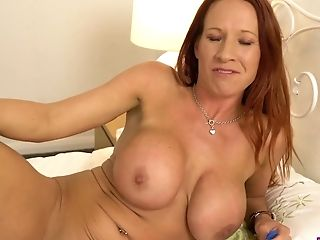 This hot buxom redhead loves playing with her panties and she is stupid horny