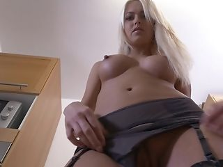 Long haired elegant blonde bombshell Lena Love strips in the kitchen
