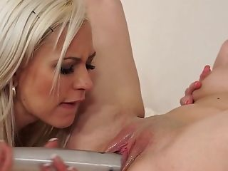 Blonde Beatrice gets her wet hole tongue fucked to orgasm by Tracy D in lesbian action