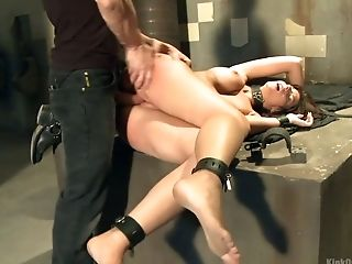 Tattooed stud punishes pussy of chained and restrained brunette Anita