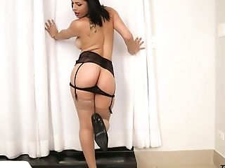 Amazing quite buxom ladyboy Bruna Castro wears black stuff and wanks her dick