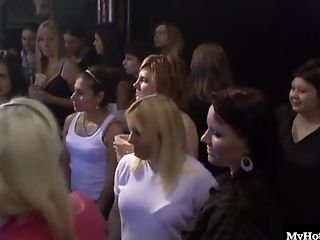Here are a group of ladies, standing around while watching a bunch of male strippers