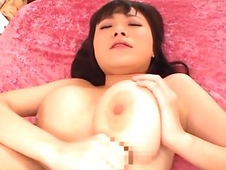 Busty babe Natsu Kimino moans while impaling herself on the wang