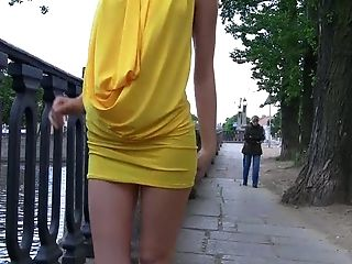 Magnificent teen cutie in yellow dress flashes her tits and pussy in public place