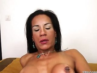 Mature trans covers herself with spunk
