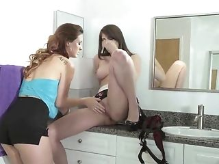 Kitchen strapon fuck moments with two horny lezzies