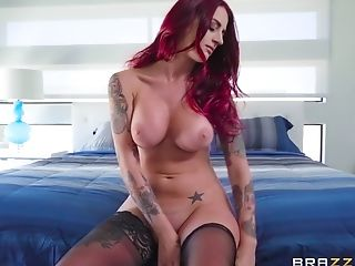 Beautiful redhead Tana Lea in black stockings getting a facial cumshot